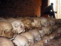 <p>A Rwandan genocide survivor is seen in this February 2004 file picture looking out of the door of a church full with human skulls and bones in the town of Ntarama. REUTERS/Finbarr O'Reilly</p>