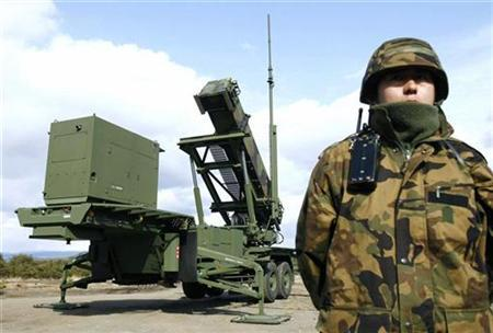 A soldier stands next to a Japanese Self-Defence Force Patriot Advanced Capability-3 (PAC-3) missile unit in Iwate Prefecture, northern Japan March 31, 2009.REUTERS/Kyodo
