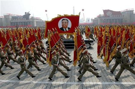 North Korea's military personnel parade with a portrait of North Korea's late leader Kim Il-sung in central Pyongyang April 25, 2007. REUTERS/Korea News Service