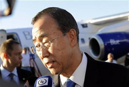 U.N. Secretary-General Ban Ki-moon speaks to a reporter after arriving in Vantas, Finland in this May 25, 2009 file photo. The impact of climate change is accelerating at an ''alarming'' pace and urgent action must be taken, Ban said on Wednesday. REUTERS/Lehtikuva/Sari Gustafsson