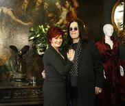 <p>Ozzy and Sharon Osbourne pose in front of some of their belongings to be auctioned in Beverly Hills, California, November 26, 2007. REUTERS/Mario Anzuoni</p>