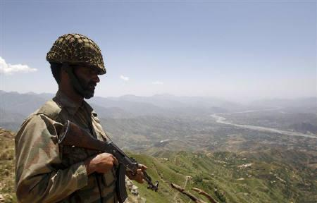 A Pakistani soldier poses on the top of Baine Baba Ziarat mountain in Swat district, during a trip organized by the army, May 22, 2009. REUTERS/Mian Khursheed