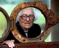 <p>Millvina Dean peers through a porthole from the Titanic September 29, 1994. Dean has died in a nursing home in England at the age of 97 the Titanic International Society said on Monday. REUTERS/Simon Kreitem</p>
