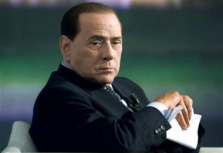 Italy's Prime Minister Silvio Berlusconi attends the taping of the television program Porta a Porta (''Door to door'' in Italian) in Rome May 5, 2009. REUTERS/Remo Casilli
