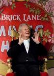 <p>Cabaret and theater star Danny La Rue speaks at a photocall to launch his two week residency at the Brick Lane Music Hall in this 1995 file photo. REUTERS/Simon Kreitem</p>