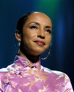 British singer Sade looks out at the crowd at the MGM Grand Garden Arena in Las Vegas in this file photo dated July 27, 2001. REUTERS/Ethan Miller