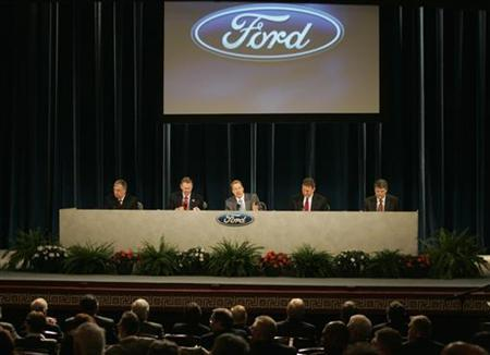 Ford Motor company executives are seated on stage (L-R) CFO Lewis Booth, CEO Alan Mulally, Executive Chairman Bill Ford, Corporate Secretary Peter Sherry and General Counsel David Leitch during the Ford Motor Company annual shareholders' meeting in Wilmington, Delaware, May 14, 2009 REUTERS/Tim Shaffer