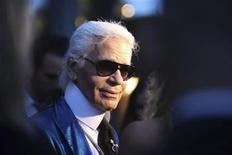 <p>Designer Karl Lagerfeld presents Chanel's 2009-2010 cruise collection at the Excelsior hotel on the Venice Lido May 14, 2009. Picture taken May 14, 2009. REUTERS/Manuel Silvestri</p>