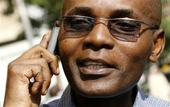 <p>Andrew Mwangura, director of the Mombasa-based East African Seafarers' Assistance Program, talks on his cell phone after an interview with Reuters in Kenya's capital Nairobi June 3, 2009.REUTERS/Thomas Mukoya )</p>