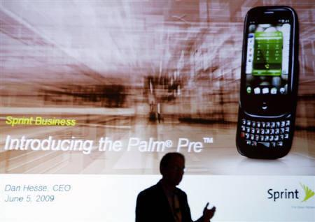 Dan Hesse, Chief Executive Officer of Sprint Nextel Corp., is silhouetted during a news conference announcing the launch of the Palm Pre smartphone in New York June 5, 2009. REUTERS/Shannon Stapleton