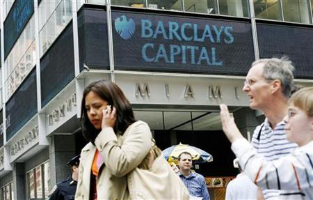 People stand outside Barclays Capital offices in New York June 8, 2009. REUTERS/Shannon Stapleton