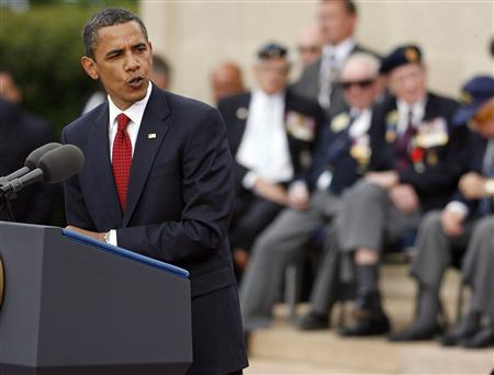 President Barack Obama addresses attendees of the 65th anniversary of the allied landings at the U.S. war cemetery at Colleville-sur-Mer June 6, 2009. REUTERS/Mal Langsdon