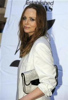 British fashion designer Stella McCartney poses as she arrives for a party by Established & Sons design house during Milan's Furniture Fair in Milan, April 22, 2009. REUTERS/Paolo Bona