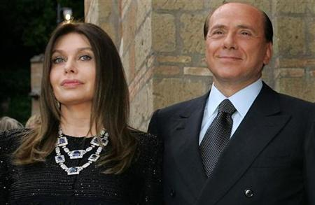 Silvio Berlusconi and his wife Veronica arrive for dinner with former President George W. Bush at Villa Madama in Rome in this June 4, 2004 file photo. REUTERS/Alessandro Bianchi/Files