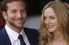 "<p>Actors Bradley Cooper (L) and Heather Graham arrive for the UK premiere of ""The Hangover"" in Leicester Square, central London June 10, 2009. REUTERS/Luke MacGregor</p>"