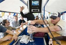 <p>Tourists cycle as they drink beer and sing karaoke on a beer bike in Amsterdam June 12, 2009. REUTERS/Robin van Lonkhuijsen/United Photos</p>