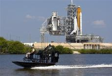 <p>A NASA security officer patrols the waters near the space shuttle Endeavour as it sits on launch pad 39A at the Kennedy Space Center in Cape Canaveral, Florida June 16, 2009. REUTERS/Scott Audette</p>