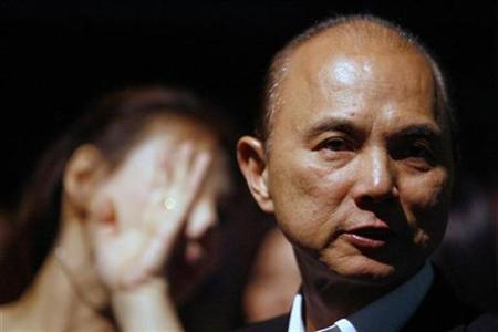 Designer Jimmy Choo attends the Vivienne Tam Autumn/Winter collection during the Singapore Fashion Festival 2007 March 23, 2007. REUTERS/Nicky Loh