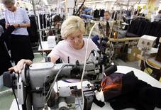 <p>A Bosnian worker sews at the Borac garment maker in the central town of Travnik June 3, 2009. The factory assembles clothing for labels such as Hugo Boss, Pierre Cardin and Burberry, using their fabrics and designs. REUTERS/Danilo Krstanovic</p>