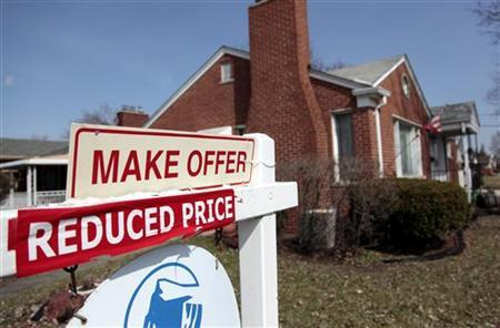A house for sale has a ''Reduced Price'' sign in front of it in Dearborn, Michigan, March 27, 2009. REUTERS/Rebecca Cook