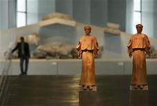 <p>Two 1st-3rd century AD. terracotta statues are on display at the entrance of the new Acropolis museum in Athens June 17, 2009. The museum will open its gates to the public on June 20. REUTERS/Yiorgos Karahalis</p>