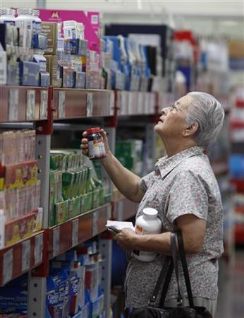 A customer shops in the Pharmacy aisle at Sam's Club, a division of Wal-Mart Stores in Bentonville, Arkansas June 4, 2009. REUTERS/Jessica Rinaldi
