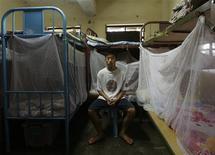 <p>Eighteen-year-old Ng Ka-chun poses inside a dormitory at the Christian Zheng Sheng College, a drug rehabilitation centre, at a remote area on Hong Kong's Lantau island June 22, 2009. REUTERS/Bobby Yip</p>