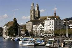 <p>People walk along the Limmat River in front of the Grossmuenster church in the Swiss city of Zurich April 20, 2008. (EURO 2008 PREVIEW) REUTERS/Arnd Wiegmann</p>