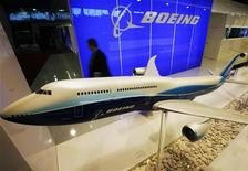 <p>A man walks past a display at the Boeing booth at the Singapore Air Show in Singapore February 19, 2008. REUTERS/Vivek Prakash</p>