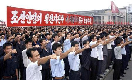 North Koreans take part in a mass rally marking anti-U.S. Day at the Kim Il-sung Square in Pyongyang on the 59th anniversary of the start of the Korean War (1950-53) June 25, 2009, in this picture released by North Korea's official news agency KCNA. The red banners read, ''Exterminate the U.S. invader, North Korean's sworn enemy!'' QUALITY FROM SOURCE REUTERS/KCNA