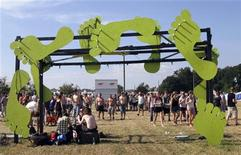 <p>An archway of green footprints welcomes visitors to the Climate Community, an environmentally-friendly camping spot at this year's Roskilde music festival, June 28, 2009. REUTERS/Henriette Jacobsen</p>