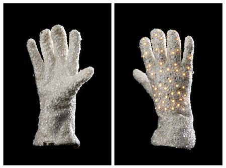 The back and front views of a white glove worn by Michael Jackson during ''The Victory Tour''. REUTERS/Profiles in History/Handout