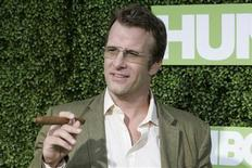 "<p>Actor Thomas Jane, star of the new HBO comedy series ""Hung"", poses with a cigar at the series premiere in Hollywood June 24, 2009. REUTERS/Fred Prouser</p>"