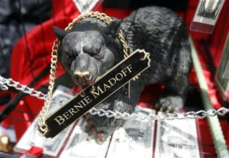 A statue of a bear with a nametag hanging from it referring to disgraced financier Bernard Madoff brought by an onlooker sits on a cart outside the United States Courthouse in lower Manhattan, June 29, 2009, during Madoff's sentencing hearing. Madoff was sentenced to 150 years in prison on Monday for perpetrating the biggest and most brazen investment fraud in Wall Street history. REUTERS/Shannon Stapleton