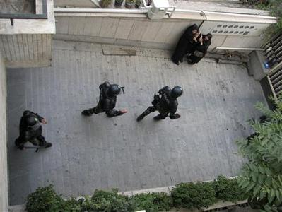 Police in full riot gear walk past residents in this undated photo uploaded to Twitter July 1, 2009. REUTERS/Twitter