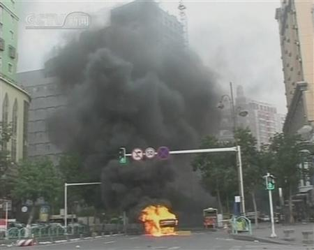 A video grab from CCTV shows a vehicle set on fire in Urumqi, Xinjiang Autonomous Region, China July 6, 2009. REUTERS/CCTV via Reuters TV