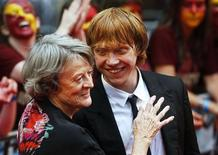 "<p>Actors Maggie Smith and Rupert Grint share a light moment on the red carpet as they arrive for the world premiere of ""Harry Potter and the Half Blood Prince"" at Leicester Square in London July 7, 2009. REUTERS/Luke MacGregor</p>"