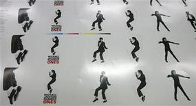 <p>Freshly printed covers of Michael Jackson's 'Number Ones' CD are pictured in the Austrian 'ArtPress' factory in Hoefen July 3, 2009. REUTERS/Dominic Ebenbichler</p>