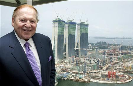 Las Vegas Sands Chairman Sheldon Adelson poses for a photo with its Marina Bay Sands Casino construction sites in the background after an interview with Reuters in Singapore July 8, 2009. REUTERS/Tim Chong