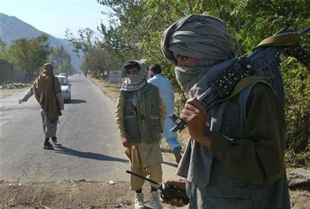 In this file photo Masked Pakistani pro-Taliban militants who are supporters of Maulana Fazlullah, a hardline cleric, stand at a check post in Charbagh, a Taliban strong hold, near Mingora, the main town of Pakistan's Swat valley lying close to Pakistan's lawless tribal belt bordering Afghanistan November 2, 2007. The leader of Pakistani Taliban fighters in the Swat valley, northwest of Islamabad, has been wounded in fighting, a military spokesman said on Wednesday citing ''credible'' information. REUTERS/Sherin Zada Kanju