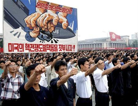 North Koreans take part in a mass rally marking anti-U.S. Day at Kim Il-sung Square in Pyongyang on the 59th anniversary of the start of the Korean War, June 25, 2009. The banner reads, ''Crush the nuclear war provocation and manoeuvres by the U.S.!'' REUTERS/KCNA