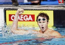 <p>O norte-americano Aaron Peirsol estabeleceu novo recorde mundial dos 100 metros costas nesta quarta-feira, marcando 51,94 segundos no campeonato nacional dos Estados Unidos. REUTERS/Christinne Muschi</p>