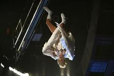 "<p>Sacha Baron Cohen as ""Bruno"" caught upside down on a wire during his entrance at the 2009 MTV Movie Awards in Los Angeles, May 31, 2009. REUTERS/Mario Anzuoni</p>"