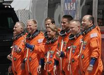 <p>The crew of the space shuttle Endeavour departs crew quarters for launch pad 39A at the Kennedy Space Center in Cape Canaveral, July 12, 2009. From left are David Wolf, Timothy Kopra, Thomas Marshburn, Canadian Space Agency astronaut Julie Payette, Christopher Cassidy, Pilot Douglas Hurley and Mission Commander Mark Polansky. REUTERS/Molly Skipper</p>