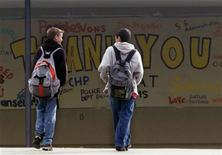 <p>A couple of young boys arrive back at school at Santana High School in Santee, California on March 7, 2001. REUTERS/Mike Blake</p>
