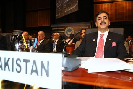 Pakistan's Prime Minister Yousaf Raza Gilani (R) attends the Non-Aligned Movement (NAM) summit in Sharm el-Sheikh July 15, 2009. REUTERS/Chris Bouroncle/Pool
