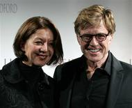 "<p>Robert Redford poses with his girlfriend Sibylle Szaggars at the premiere of ""Lions for Lambs"" in Paris, October 25, 2007. REUTERS/Benoit Tessier</p>"