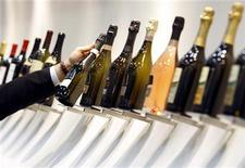 <p>A man holds a bottle of champagne at the Vinitaly wine expo in Verona April 3, 2009. REUTERS/Alessandro Garofalo</p>