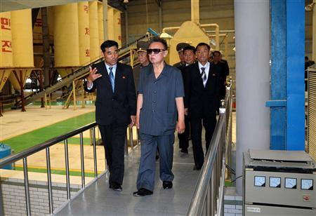 North Korean leader Kim Jong-il (C) visits the newly built Taedonggang Tile Factory in Pyongyang in this picture released by North Korea's official news agency KCNA late July 14, 2009. KCNA did not state expressly the date when the picture was taken. REUTERS/KCNA