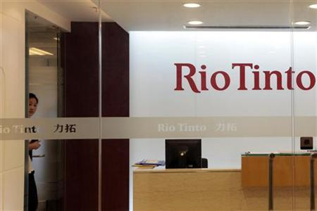 A employee is seen at Rio Tinto Limited Shanghai Representative Office in Shanghai July 8, 2009. REUTERS/Aly Song